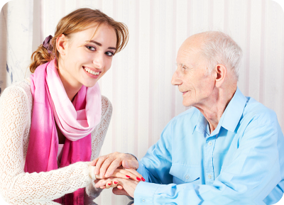 caregiver holding the hands of old man
